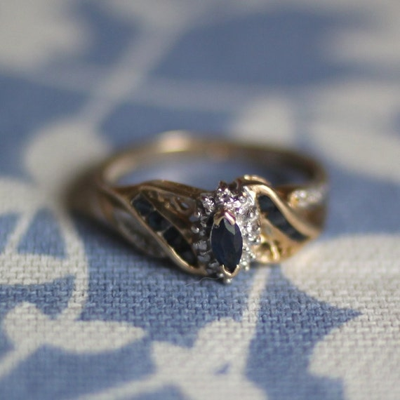 Petite dark blue sapphire marquise with diamonds