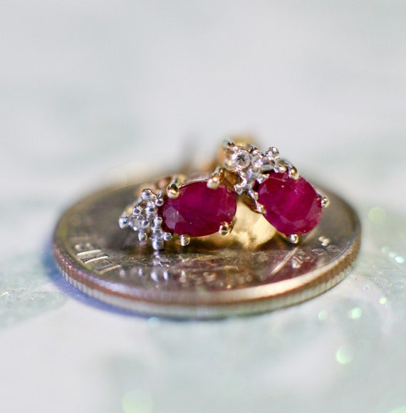 Cute as a bee's knee's. Ruby and diamond earrings in 10k yellow gold.