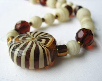 Art Glass Beaded Necklace Striped Lampwork Amber Creme Bronze Nana's Pocket Candy