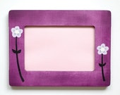 Purple photo frame with flowers