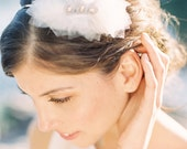 Audra head band made in off white tulle with silver and pearl center