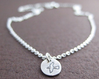 Fly. Tiny Sterling Silver Peace Dove Necklace.