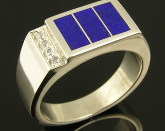 Sterling silver man's ring inlaid with lapis accented by white sapphires.