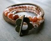 Soft orange round and rice quartz beads and crochet bracelet
