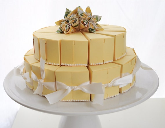 Two tiered yellow paper cake with flowers and icing