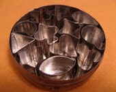 vintage tin of miniature cookie CUTTERS aspic or jelly