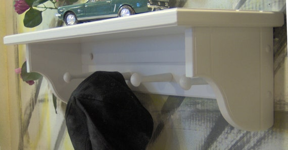 """white 24"""" shelf 5 and one half"""" deep with pegs"""