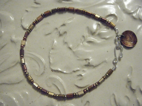 Anklet of Bronze and Copper Beads with Shell Dangle