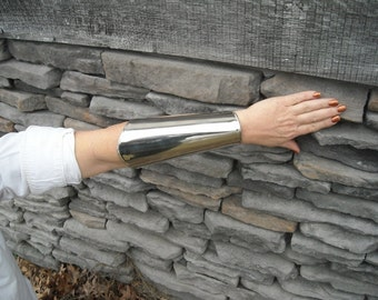 Stainless Steel Bracer Curved edge.