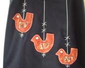 Black bird charms skirt with William Morris applique