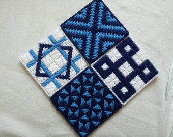 set of 4 plastic canvas coasters in blues and white