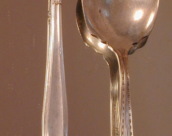 Pair of Jelly Spoons by Holmes and Edwards and SL GHR Co.