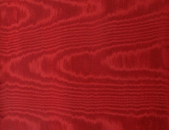 A Silky Moire Fabric Remnant In A Deep Burgundy