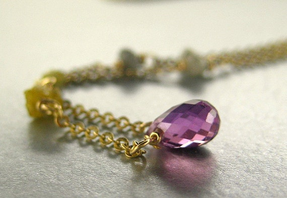 14k gold yellow gold necklace, purple sapphire briolette with raw diamonds.