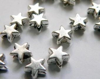 20 itty bitty teenie wennie silver spacer stars