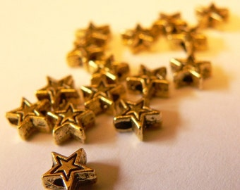 Tiny Gold Spacer Stars