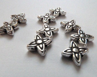 10 Silver flower spacers beads