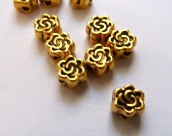 10 Gold flower spacer beads