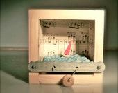 sailboat automaton in music note box
