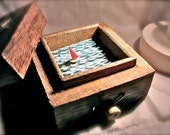 nautical wooden sailboat automaton in upcycled box