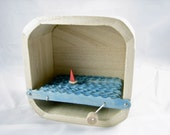 wooden boat automaton in plain box