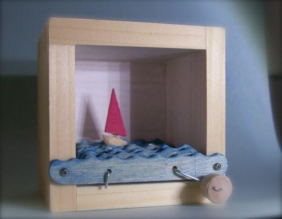 hand crank boat in a box automata (white box/red sail)