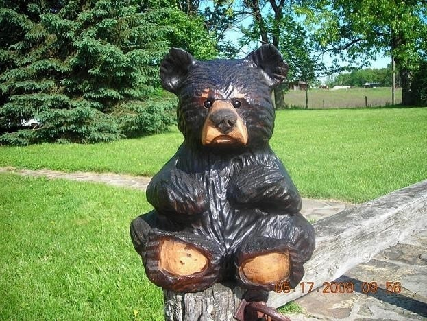 Chainsaw carved baby bear wood sculpture