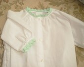 White baby daygown with mint crochet edging