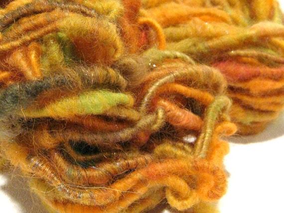 Orange Spritzer handspun sparkly corespun art yarn 60 yds