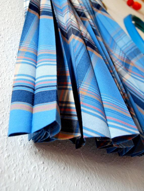 A vintage blue tartan long wool skirt from Belgium