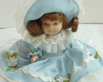 vintage ceramic doll, glass doll, vintage doll, blue dress, pretty doll, vintage home decor,brown hair,unique doll,nursery decor,collectible