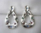 Vintage Emmons silver tone clip back earrings with multi color rhinestones