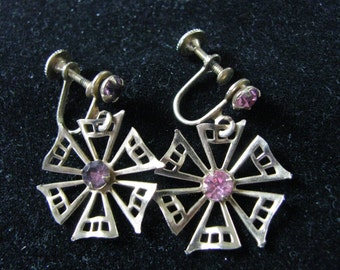 Pretty gold tone  pinwheel scew back earrings with pink rhinestone centers