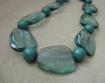 Shades of green vintage necklace with flat & round beads