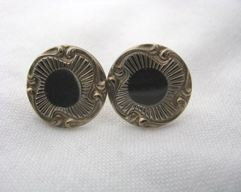 Gold tone vintage screw back earrings with textured swirl border