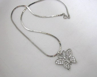 Silver tone butterfly pendant necklace with rhinestones by Motif
