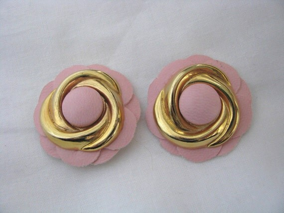 Pair of pale pink leather flower shaped shoe clips with shiny gold tone metal accents