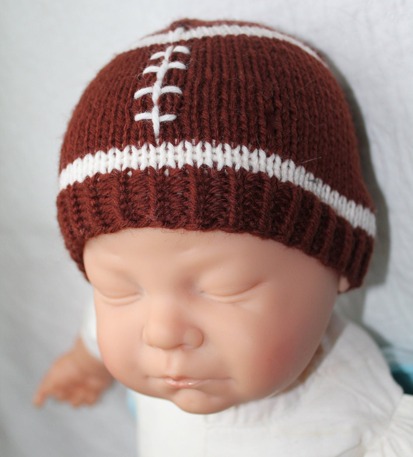 Crochet Pattern Baby Hat Free : KNITTING PATTERN Football Baby Hat Size 0 to 3 and 6 to 12