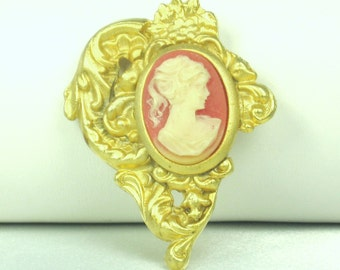 Plastic and Gold Tone Metal Cameo Brooch