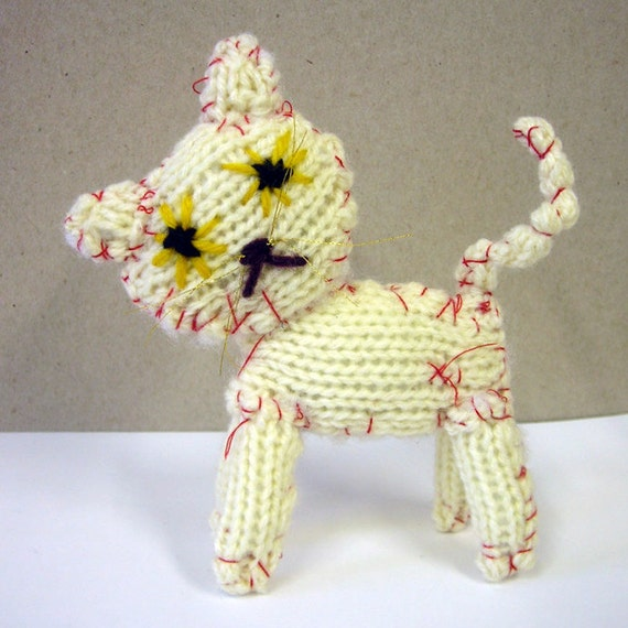 knitted cat - very messy cat - white