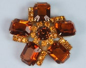 Vintage Rhinestone Brooch Topaz Glass Pinwheel Design