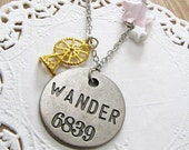 wanderstar necklace. wander word stamped pendant with ferris wheel and semiprecious stars
