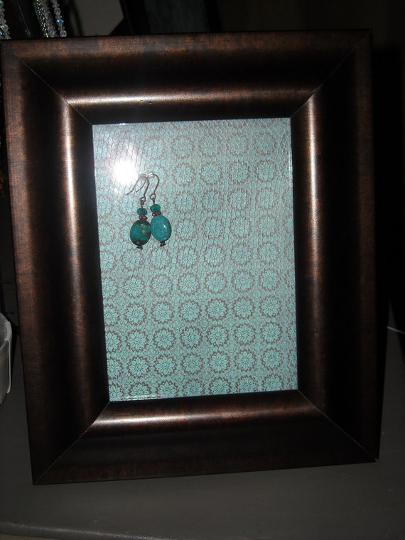 Jewelry Frame Holder with Brown Frame and Turquoise Background