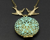 Patina locket and a sparrow - Necklace