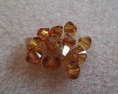 12pk Swarovski Crystal 5mm Bicone Crystal Copper