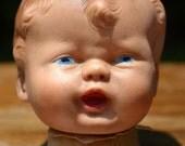 creepy vintage baby head