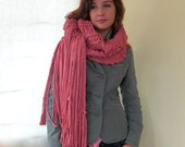 Big pink knitted scarf of eco T -yarn