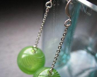 Green globe long dangle earrings