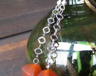 Diamond-shaped red glass bead dangle earrings