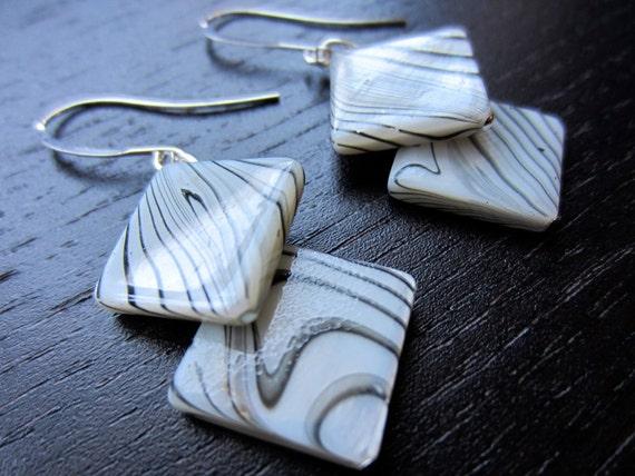 Zebra colored shell dangle earrings